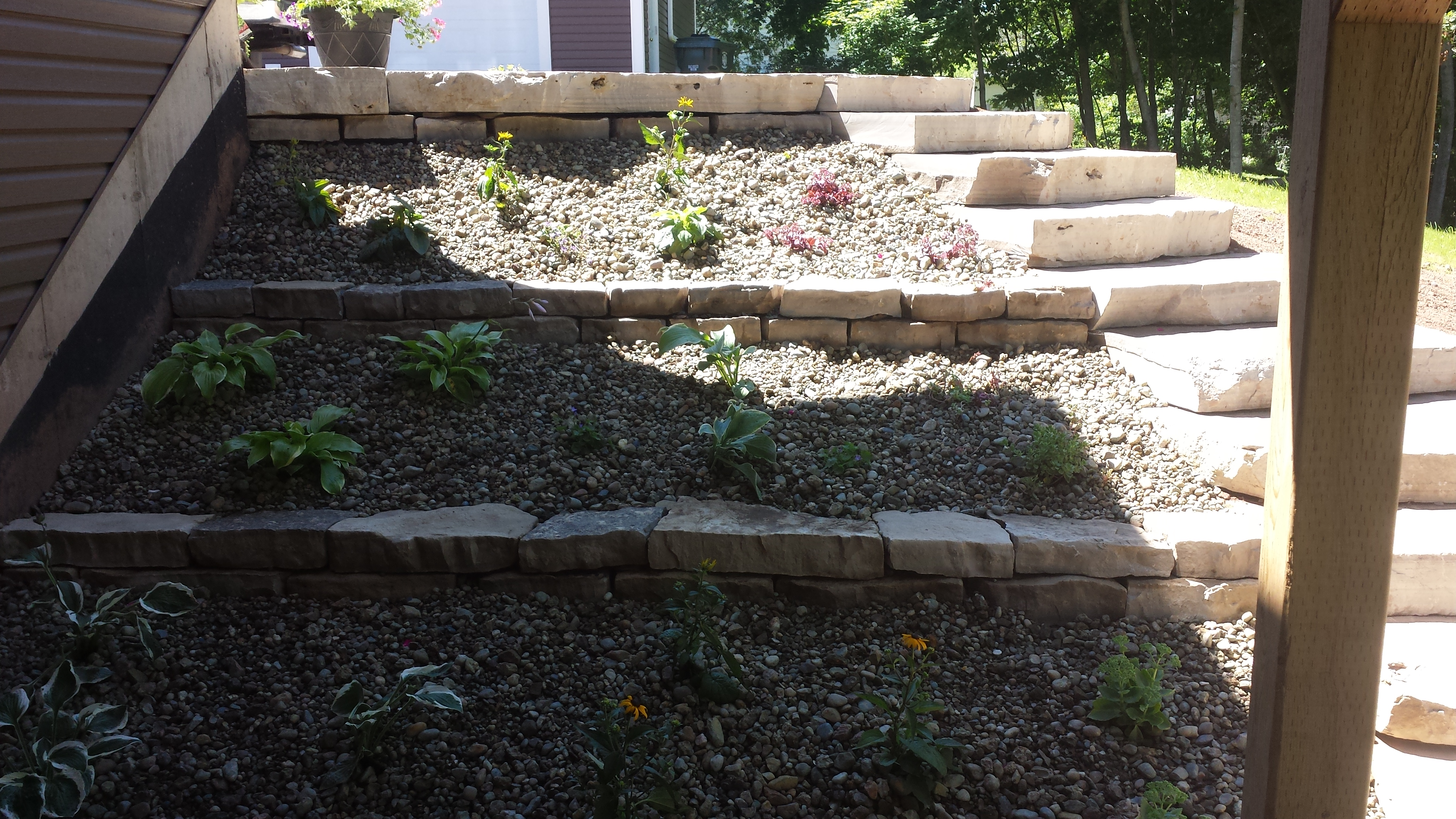 Elevated stepping stone flower bed